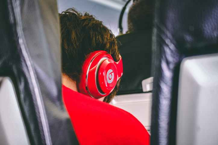 man wearing red beats by dre headphones