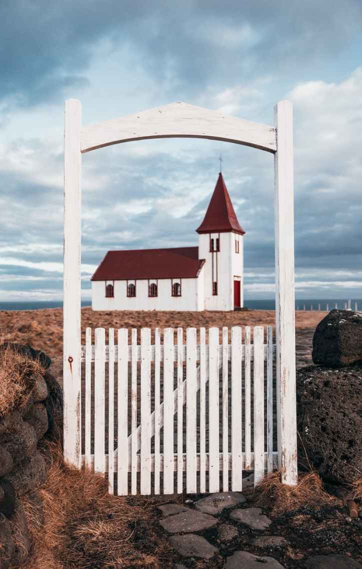 photo of white wooden church during daytime